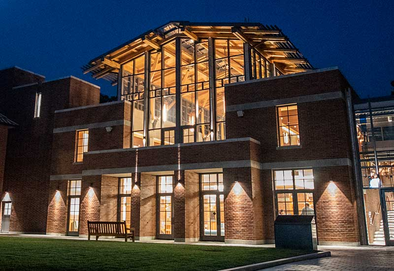 Night time image of finished project using RF dried heavy timber, glulam and custom steel connections.