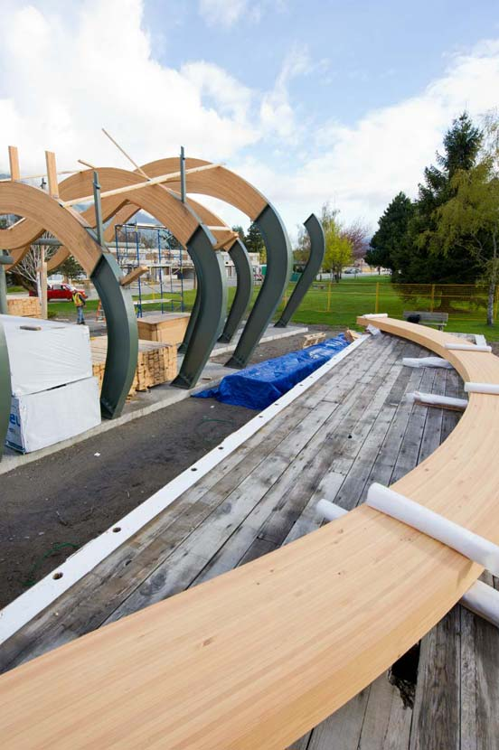 Site erection of prefabricated douglas fir glulam components.