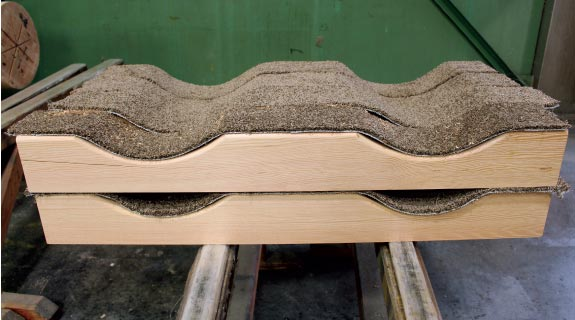 Cradles for CNC fabricated round glulam components