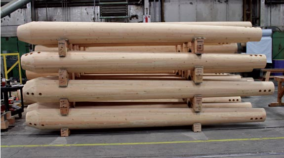 CNC fabricated glulam posts ready for stain