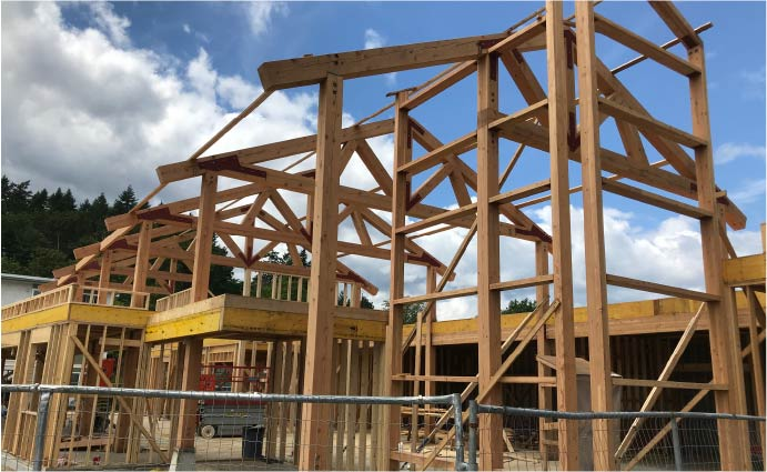 CNC Fabricated douglas fir timber trusses installed during construction
