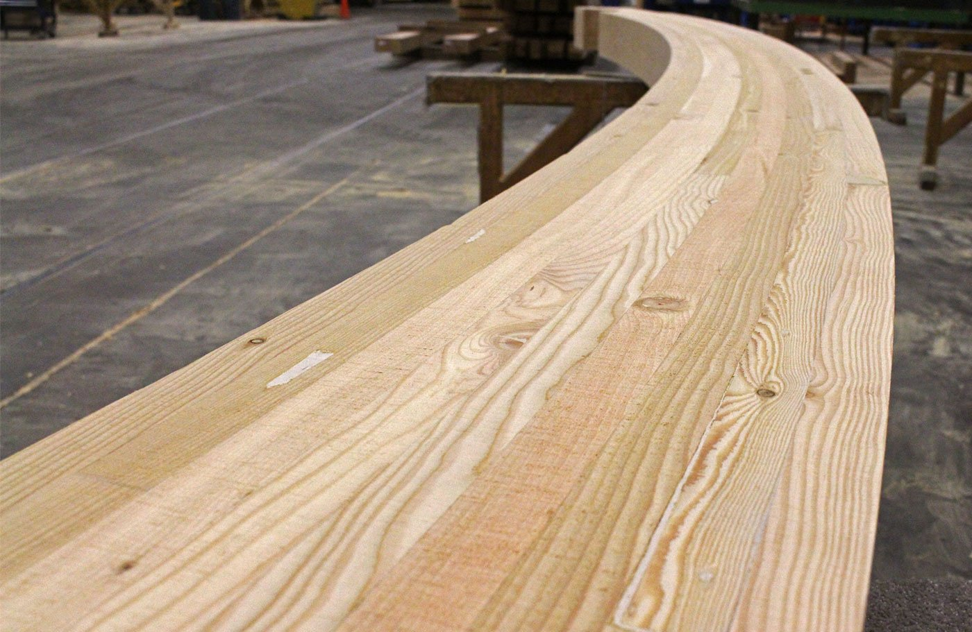 Custom texture on curved douglas fir glulams