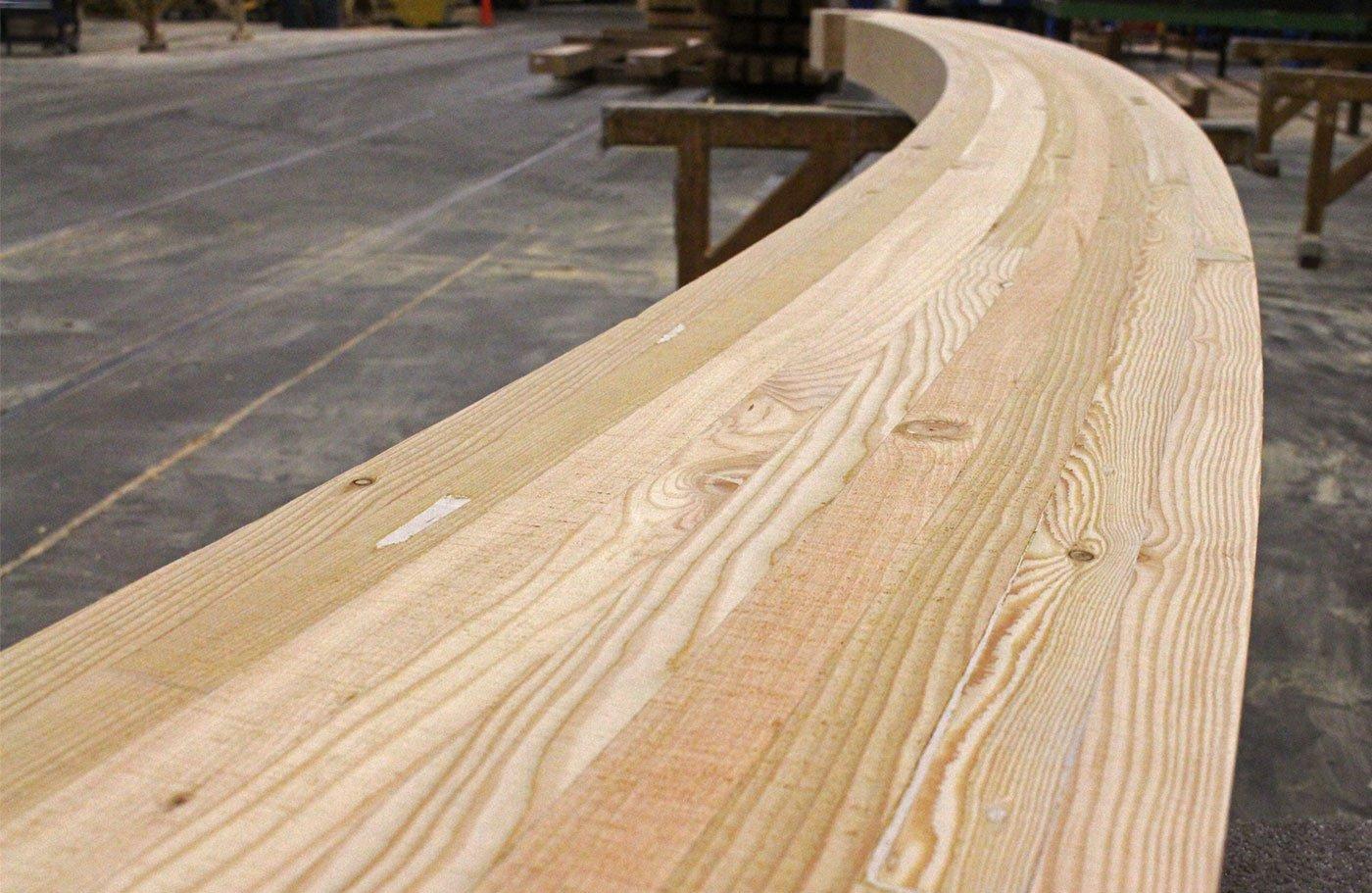 Custom texture on curved douglas fir glulams
